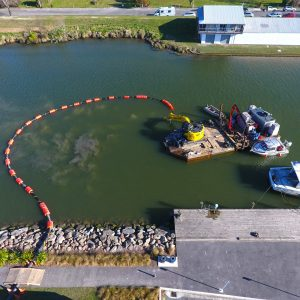 Suction dredging Kaiapoi River for the Kaiapoi Marine Precinct.