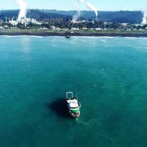 View of shore transition, NZDS work boat Shoman over the point where the shore transition section exits onto the seabed. Sheet pile structure at waters edge marks the location of the leak